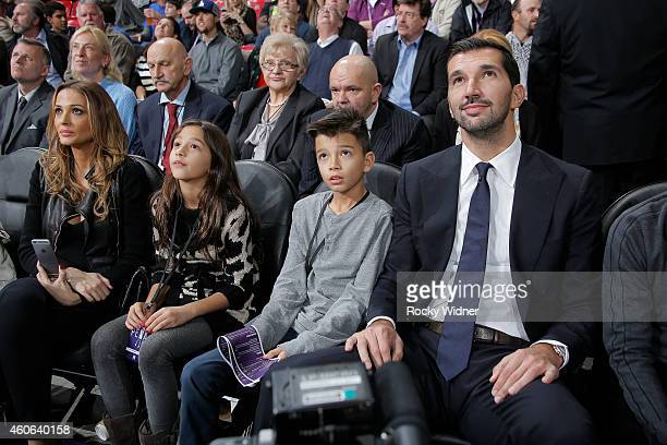 Former Sacramento Kings Peja Stojakovic sits with his wife Aleka Kamila and their kids as his jersey is retired during halftime against the Oklahoma...
