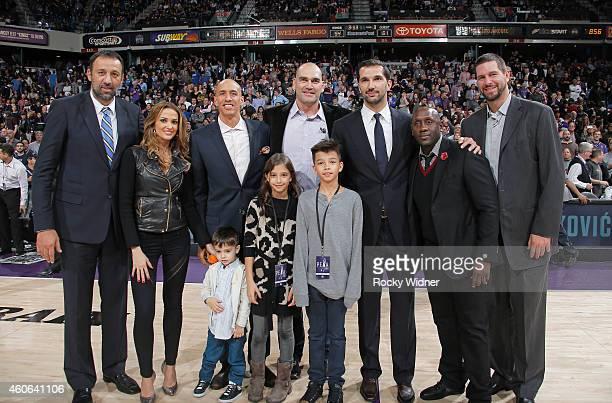 Former Sacramento Kings players Vlade Divac Doug Christie Scot Pollard Bobby Jackson and Brad Miller and Sacramento Kings owner Vivek Ranadivé pose...