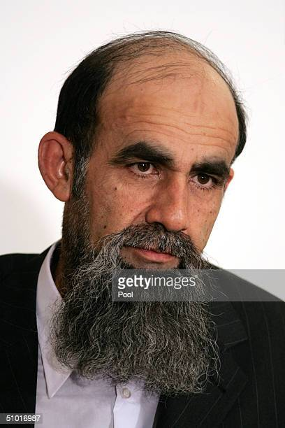 Former Saddam Hussein Lieutenant Abid Hamid Mahmud alKhatab listens as a list of charges that he along with 10 other high level defendents and...