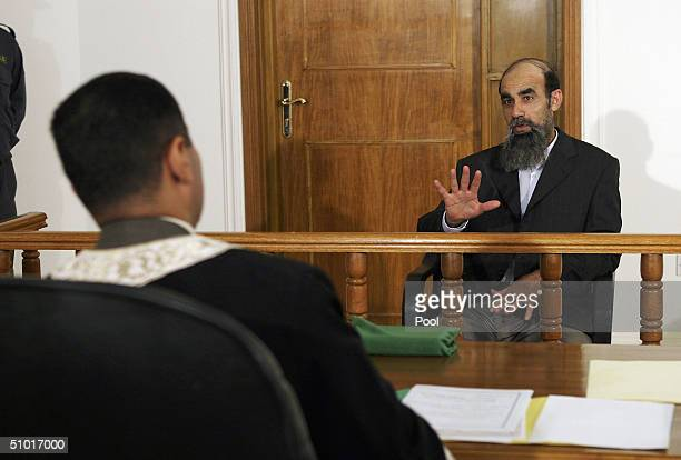 Former Saddam Hussein Lieutenant Abid Hamid Mahmud alKhatab responds as a list of charges that he along with 10 other high level defendents and...