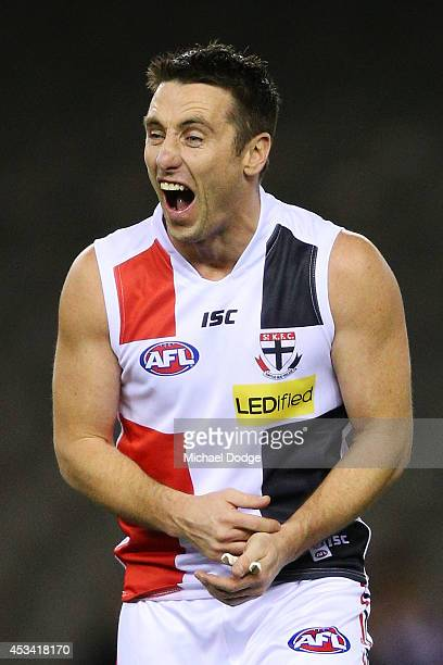 Former Saints player Stephen Milne reacts while playing a corporate match before the round 20 AFL match between the St Kilda Saints and the Western...