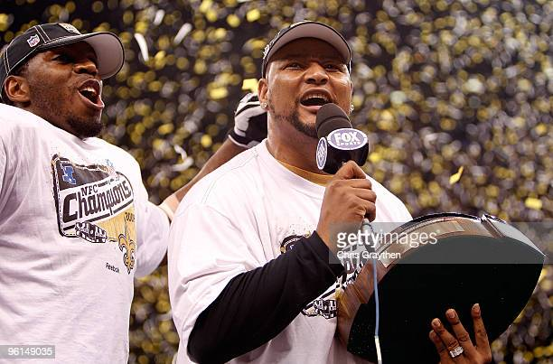 Former Saints running back Deuce McAllister and Jonathan Vilma of the New Orleans Saints celebrate with the NFC Championship trophy after their 3128...