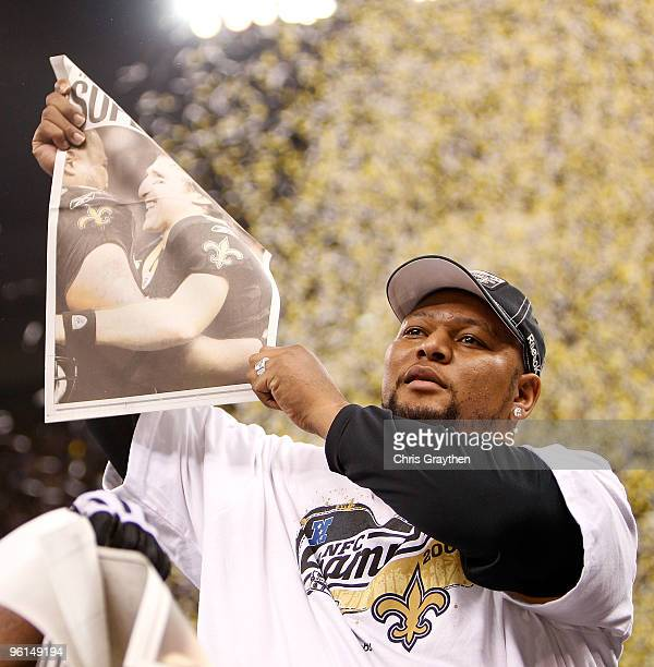 Former Saints' running back Deuce McAllister celebrates after the the New Orleans Saints won 3128 in overtime against the Minnesota Vikings during...