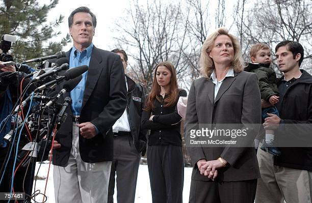 Former Salt Lake Organizing Committee President Mitt Romney, surrounded by his family, speaks at a press conference March 19, 2002 at his home in...