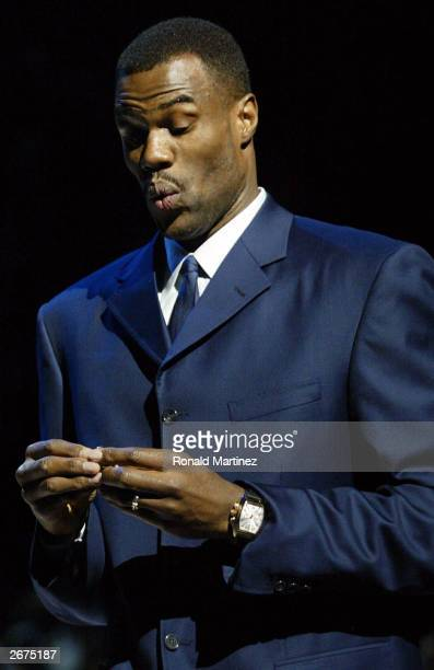 Former San Antonio Spur David Robinson puts on his 2003 NBA Championship ring prior to the Spurs season opener against the Phoenix Suns October 28...