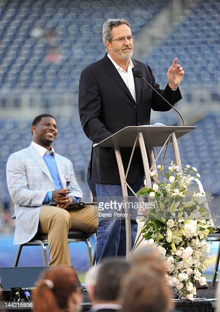 Former San Diego Chargers quarterback Dan Fouts speaks as LaDainian Tomlinson looks on during a memorial for former San Diego Chargers star football...