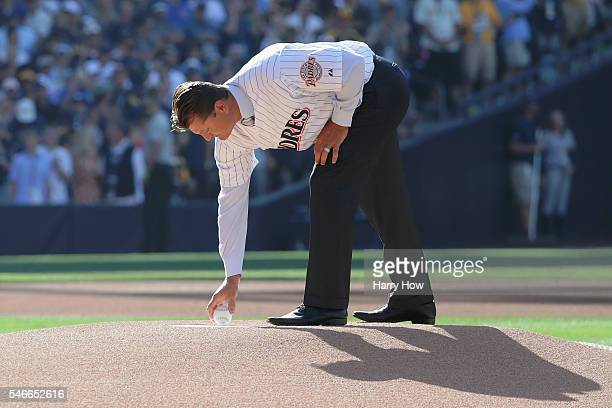 Former San Diego Padre Trevor Hoffman places the game ball on the pitcher's mound prior to the 87th Annual MLB AllStar Game at PETCO Park on July 12...