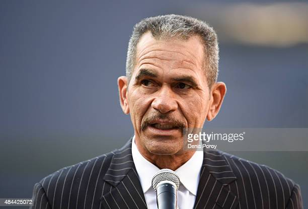 Former San Diego Padres catcher Benito Santiago speaks as he's inducted into the San Diego Padres Hall of Fame before a baseball game between the...