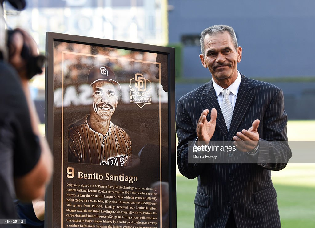 Former San Diego Padres catcher Benito Santiago stands next to his plaque as he's inducted into the San Diego Padres Hall of Fame before a baseball game between the Philadelphia Phillies and the San Diego Padres at Petco Park August 8, 2015 in San Diego, California.