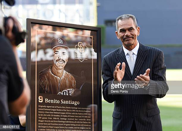Former San Diego Padres catcher Benito Santiago stands next to his plaque as he's inducted into the San Diego Padres Hall of Fame before a baseball...