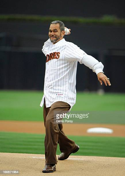 Former San Diego Padres catcher Benito Santiago throws out the first pitch before a baseball game between the San Diego Padres and Colorado Rockies...