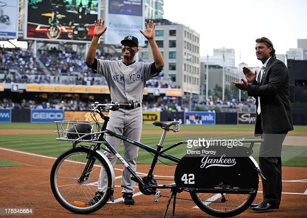 Former San Diego Padres pitcher Trevor Hoffman claps as Mariano Rivera of the New York Yankees is presented with a beach cruiser bike before a...