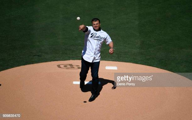 Former San Diego Padres pitcher Trevor Hoffman throws out the ceremonial first pitch during pregame ceremonies on Opening Day between the Milwaukee...