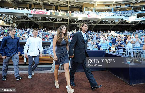 Former San Diego Padres pitcher Trevor Hoffman walks onto the field with his wife Tracy Hoffman during a ceremony inductiing him into the Padres Hall...
