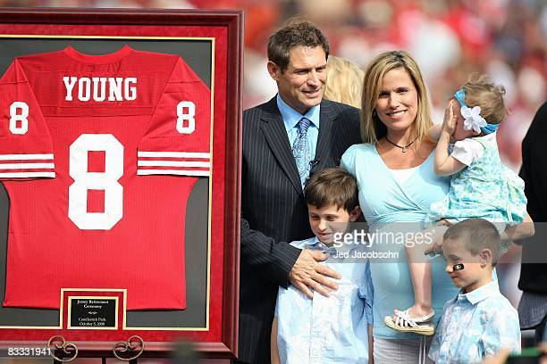 Former San Francisco 49ers quarterback Steve Young poses for picture with his family during a ceremony to retire his number at halftime of the New...