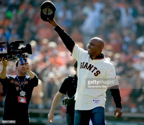 Former San Francisco Giant star Barry Bonds is all smiles after throwing out the ceremonial first pitch to a standing ovation prior to action against...