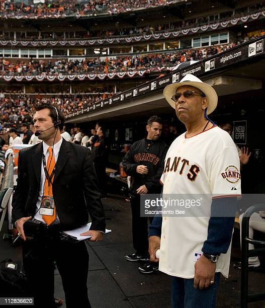 Former San Francisco Giant star Orlando Cepeda right waits in the dugout for his introduction to help throw out the ceremonial first pitch against...