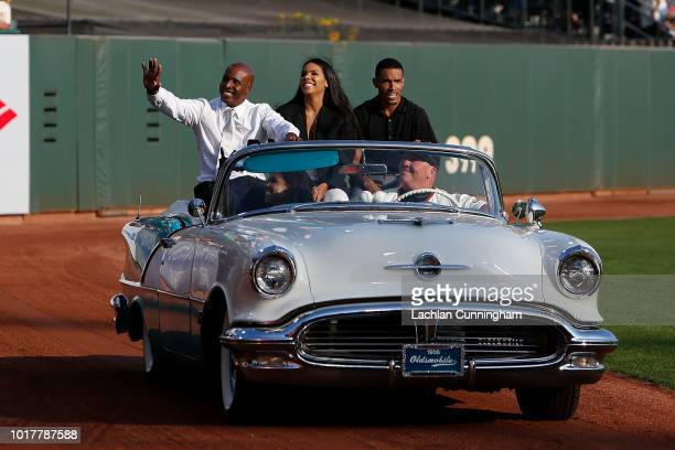 Former San Francisco Giants Barry Bonds takes a lap of honor with his children Shakari Nikolai and Aisha after a ceremony to retire his number 25...