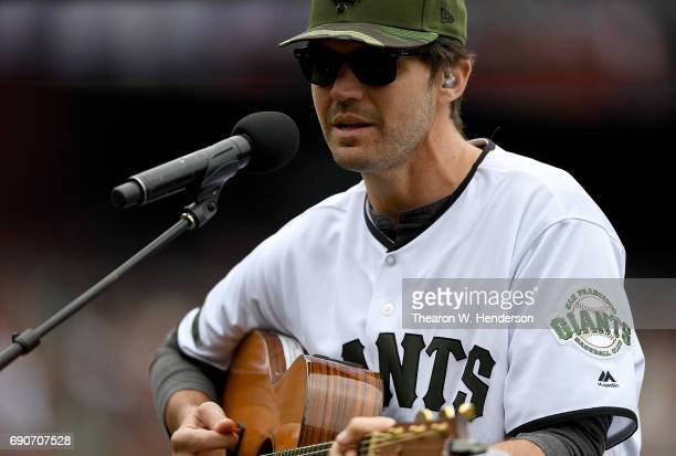 Former San Francisco Giants Barry Zito performs playing the guitar and singing prior to the start of a Major League Baseball game between the San...