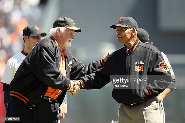 Former San Francisco Giants Gaylord Perry shakes hands with Felipe Alou before the Giants opening day game against the Pittsburgh Pirates at ATT Park...