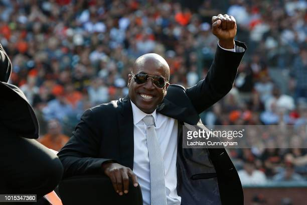 Former San Francisco Giants player Barry Bonds looks on during a ceremony to retire his jersey at ATT Park on August 11 2018 in San Francisco...