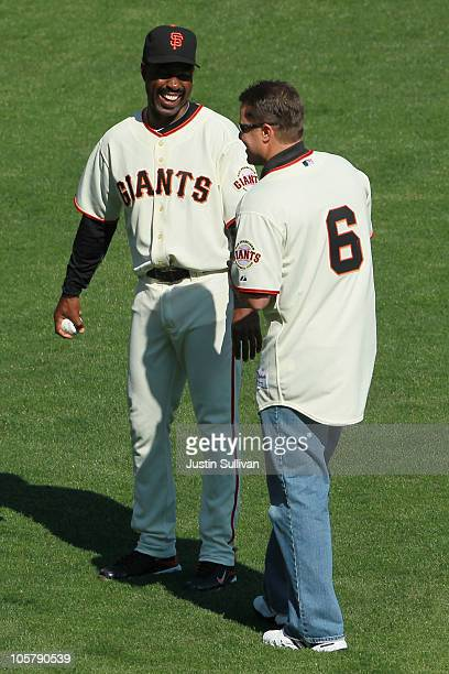 Former San Francisco Giants Shawon Dunston and JT Snow stand on the field prior to Game Three of the NLCS between the San Francisco Giants and the...