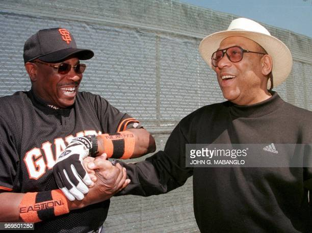 Former San Francisco Giants star Orlando Cepeda is congratulated by San Francisco Giants manager Dusty Baker during a visit to the Giants spring...