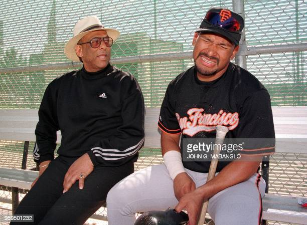 Former San Francisco Giants star Orlando Cepeda looks on as San Francisco Giants player Marvin Benard of Nicaragua reacts to a joke from Cepeda...