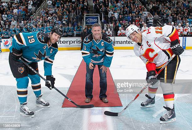 Former San Jose Shark and recently retired NHLer Owen Nolan drops the ceremonious first puck as Joe Thornton of the San Jose Sharks faces off against...