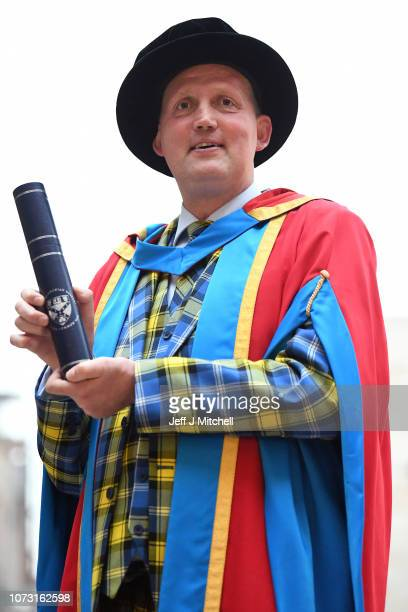 Former Scotland international rugby star Doddie Weir poses for photographers following receiving an Honorary Degree of Doctor of Science from Glasgow...