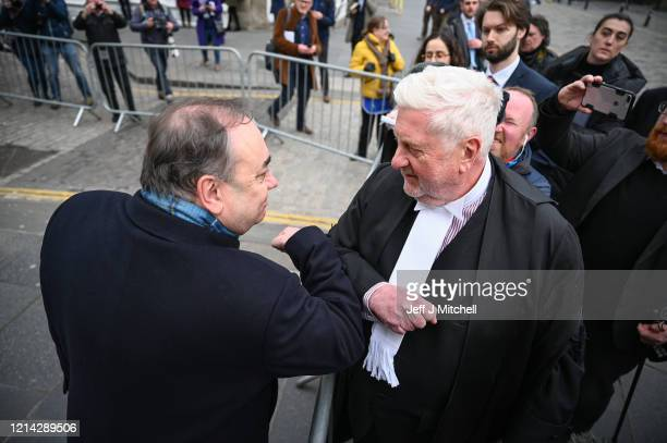 Former Scottish First Minister Alex Salmond bumps elbow with Gordon Jackson QC as he departs Edinburgh High Court on March 23, 2020 in Edinburgh,...