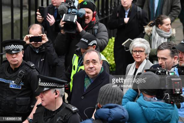 Former Scottish first minister Alex Salmond leaves the High Court surrounded by police and the media after a preliminary hearing on sexual assault...