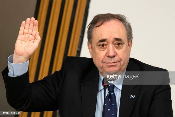 Former Scottish National Party leader and former First Minister of Scotland, Alex Salmond is sworn in before giving evidence to a Scottish Parliament...