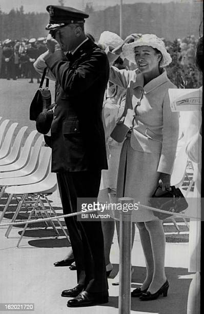 JUN 4 1969 JUN 5 1969 Former screen star Ella Raines holds her hat and takes cover behind her husband Brig Gen Robin Olds AFA commandant of cadets as...