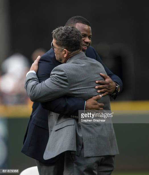Former Seattle Mariner and current hitting coach Edgar Martinez gets a hug from Hall of Fame member and former Seattle Mariner Ken Griffey Jr after a...