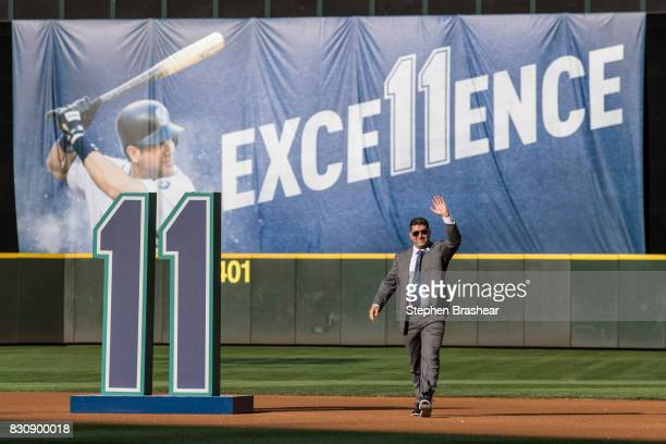 Former Seattle Mariner and current hitting coach Edgar Martinez acknowledges the crowd as he walks out during a ceremony to retire his number before...