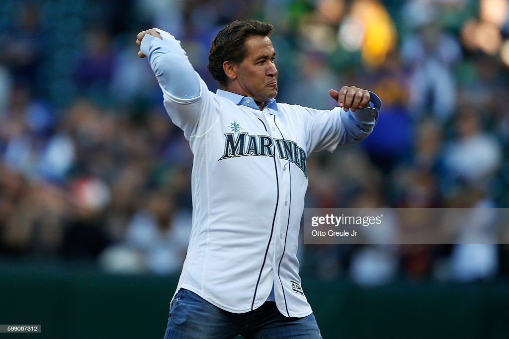 Former Seattle Mariner Bret Boone throws out the ceremonial first pitch prior to the game between the Seattle Mariners and the Los Angeles Angels of Anaheim at Safeco Field on September 3, 2016 in Seattle, Washington.