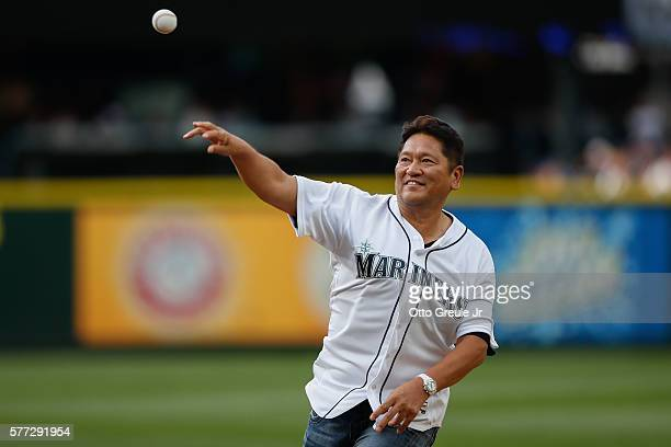 Former Seattle Mariners' closing pitcher Kazuhiro Sasaki throws out the ceremonial first pitch prior to the game between the Seattle Mariners against...