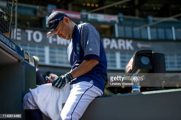 Former Seattle Mariners outfielder Ichiro Suzuki, now an instructor with the team, signs autographs before the game against the Chicago Cubs at...