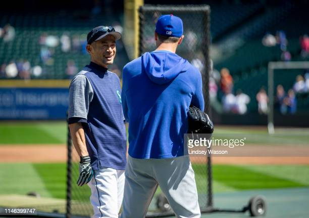 Former Seattle Mariners outfielder Ichiro Suzuki now an instructor and special assistant to the chairman talks with Cole Hamels of the Chicago Cubs...