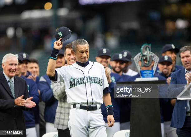 Former Seattle Mariners player Ichiro Suzuki tips his cap to the crowd as he receives the Seattle Mariners Franchise Achievement Award before the...