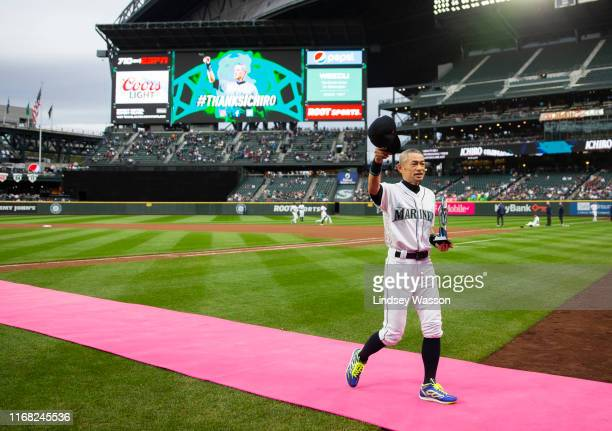 Former Seattle Mariners player Ichiro Suzuki tips his cap to the crowd as he walks off the field after receiving the Seattle Mariners Franchise...