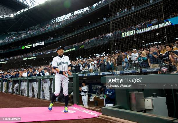 Former Seattle Mariners player Ichiro Suzuki walks onto the field as he receives the Mariners Franchise Achievement Award in a pregame ceremony...