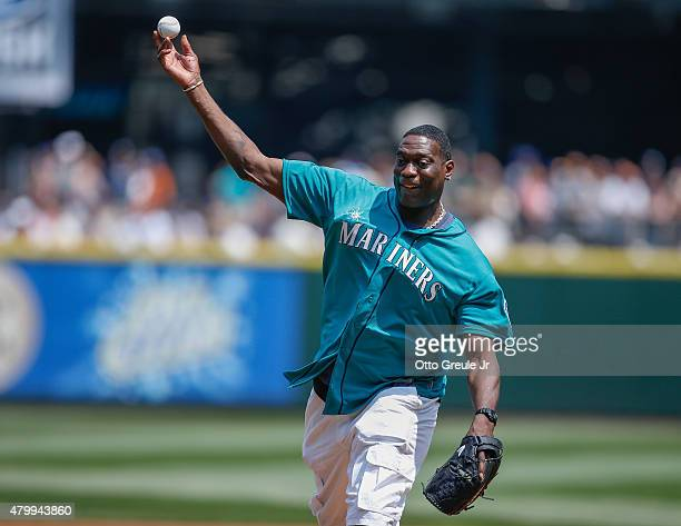 Former Seattle SuperSonic Shawn Kemp throws out the ceremonial first pitch prior to the game between the Detroit Tigers and the Seattle Mariners at...