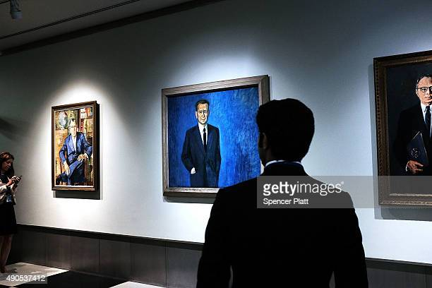 Former Secretary Generals of the United Nations are featured in paintings along a wall in the UN on September 29 2015 in New York City The ongoing...