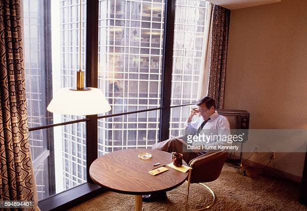 Former Secretary of Defense Donald Rumsfeld reads in his hotel room during the 1980 Republican National Convention July 1980 in Detroit Michigan