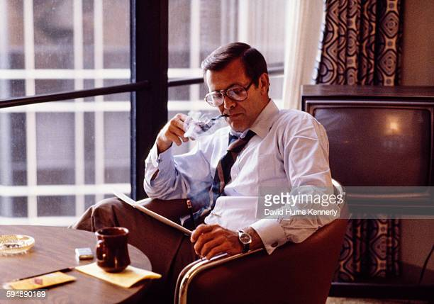 Former Secretary of Defense Donald Rumsfeld smokes his pipe in his hotel room during the 1980 Republican National Convention July 1980 in Detroit...