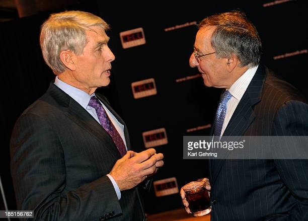 Former Secretary of Defense Leon Panetta right and US Senator Mark Udall left chatted privately during a reception prior to a talk about global...