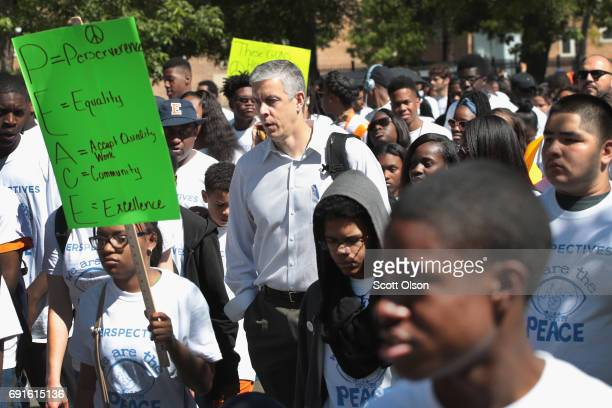 Former Secretary of Education Arne Duncan joins hundreds of charter school students marching for peace during an annual demonstration against...