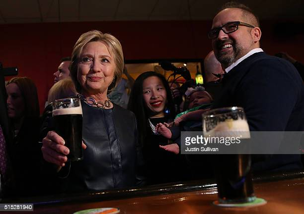 Former Secretary of State and Democratic presidential candidate Hillary Clinton has a Guiness beer at O'Donold's Irish Pub and Grill on March 12 2016...